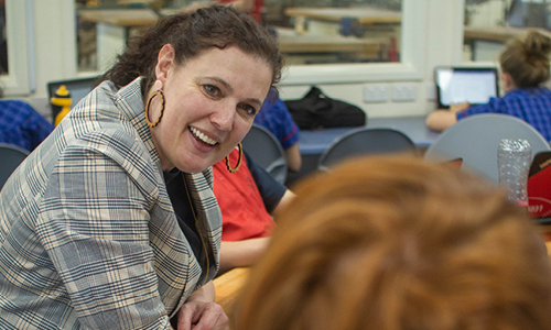 Teacher speaking with child smiling