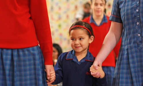 Reception student with older student smiling